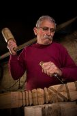 picture of woodcarving  - Old woodcarver work in the workshop 7 - JPG