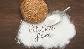Loaf Of Healthy Bread And Gluten Free Flour Scattering From Scoop, Top View poster