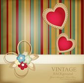 congratulation vector retro background with ribbons, flowers and two hearts on a striped background