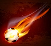 Vector flying flaming soccer ball on a brown background