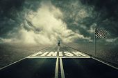 Surreal View As A Competitive Young Businessman On The Road Crossing The Finish Line. Business Chall poster
