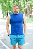 Enjoy Wellbeing And Healthy Body. Man Sporty Outfit Looks Confident Outdoors Nature Background. Guy  poster