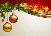 Christmas background with a branch of evergreen and gifts