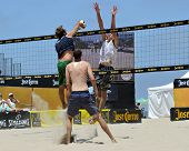 HERMOSA BEACH, CA - JULY 21: Brad Keenan, Mark van Zwieten and Andrew Fuller compete in the Jose Cue