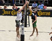 HERMOSA BEACH, CA - JULY 21: Brad Keenan and John Mayer compete in the Jose Cuervo Pro Beach Volleyb