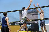 HERMOSA BEACH, CA - JULY 21: Andrew Fuller, Brad Keenan and John Mayer compete in the Jose Cuervo Pr