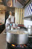 Cooking At Restaurant Kitchen