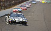 INDIANPOLIS, IN - JUL 29, 2012:  Jimmie Johnson (48) brings his car down the front stretch during th