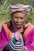 Chiang Mai, Thailand - Nov 15Th: Unidentified Woman From The Lisu Tribe Sells Traditional Clothing T