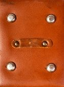 detail of old red leather briefcase