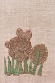 foto of peter cottontail  - Easter Bunny and Egg shaped stitched canvas on rustic background - JPG