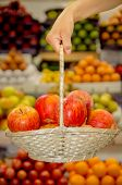 apples in a basket  against fruit background