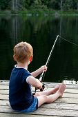 Boy Fishing On Dock