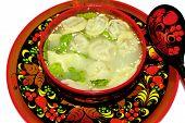 Russian Folk Dishes Called Khokhloma And Traditional Siberian Dumplings.