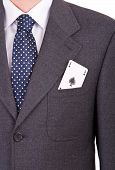 Businessman with playing card in his pocket.