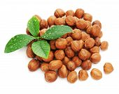 Heap Of Fresh Shelled Hazelnuts With Green Leaves Isolated On White Background.