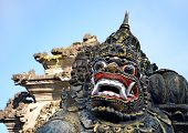 pic of tanah  - Scary stone barong mask at entrance to Tanah Lot Bali Indonesia - JPG