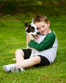 stock photo of blue heeler  - Child lovingly embraces his pet dog - JPG