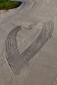 Abstract Heart In Sand