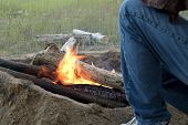 Man Builds Fire Pit Around Open Camp Fire