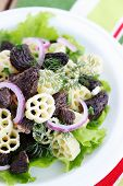 stock photo of crimini mushroom  - pasta with roasted morel onions and lettuce - JPG