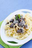 stock photo of crimini mushroom  - Pasta with braised morels in cream sauce - JPG