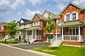 image of suburban city  - Suburban residential street with row of red brick houses - JPG