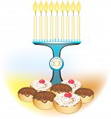 hanukkah candles with  traditional donuts
