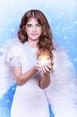 �?��?�¡ute angel, portrait of beautiful teen girl wearing fluffy wings and holding in hands c