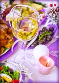 Traditional New Year beverage, champagne, glass with white wine, tasty festive food, romantic dinner