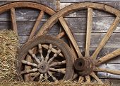 stock photo of wagon wheel  - Old wheels from a cart in shed - JPG