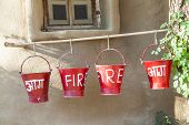 Red Fire Buckets Filled With Sand