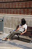 Tramp on bench, Malaga, Spain.