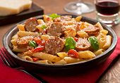 picture of sausage  - Cajun style pasta with penne spicy sausage red peppers and tomato sauce with freshly grated parmesan cheese.