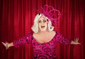 pic of drag-queen  - Happy drag queen in blond with singing in theater - JPG
