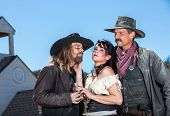 stock photo of crossed pistols  - Three Classical Western Characters In A Love Triangle - JPG