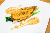 grilled barramundi steak with spicy sauce