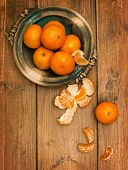 Clementines on rustic wooden board