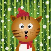 Katze und Schnee auf Bambus-Hintergrund