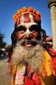 Sadhu Man Seeking Alms In Durbar Square. Kathmandu, Nepal
