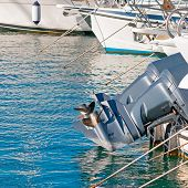 image of outboard engine  - engines and hulls in Castelsardo harbor - JPG