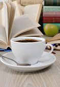 Cup Of Coffee On A Table Among Books