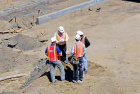picture of blue-collar-worker  - A picture of construction workers discussing work plans. ** Note: Slight graininess, best at smaller sizes - JPG