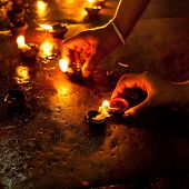 People Burning Oil Lampsl In Hindu Temple