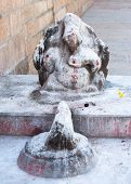 pic of meenakshi  - Ganesha statue covered with paint and rice flour as Hindu religious offerings - JPG