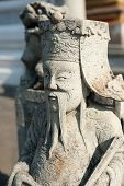 Statue Of Chinese Stone Guardian At Wat Pho Temple. Thai Traditi