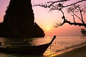 Sunset At Tropical Beach Landscape With Thai Traditional Boat An