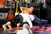 NEW YORK-MAY 23: NBC Correspondent Jenna Wolfe does push-ups on Tim McGraw at the Toyota Concert Series on the Today Show at  Rockefeller Plaza on May 23, 2014 in New York City.