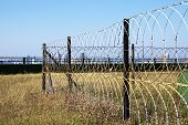 Razor Wire Security Fence Surrounding Protected Structure