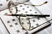 Spectacles, pencil, crossword